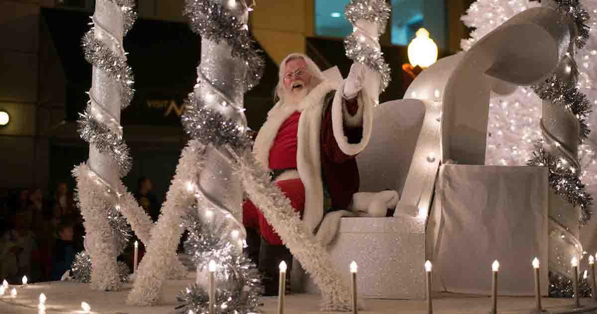 Santa waves from his sleigh at Norfolk's Grand Illumination parade