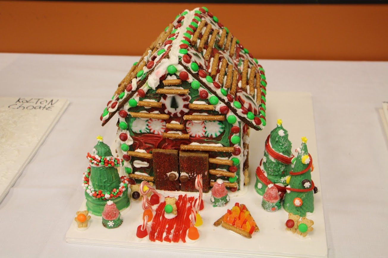 TCC student-created gingerbread house with gumdrop walkway